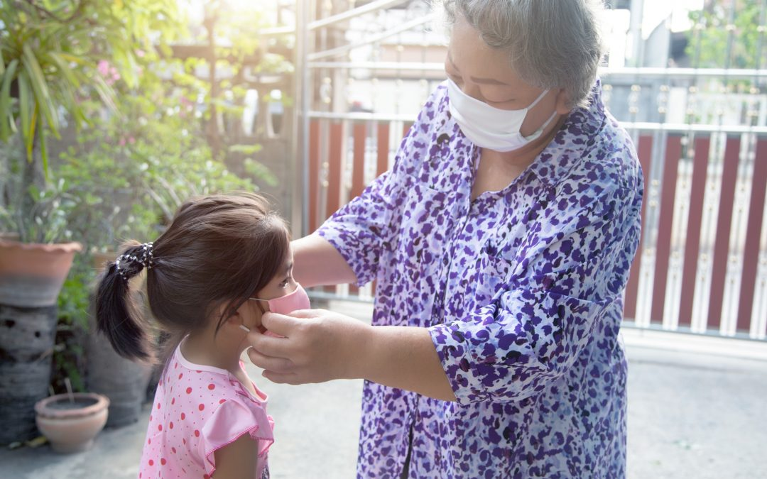 grandparent face mask to kids for protect corona virus pandemic before go outside home. alway use medical mask for protect coronavirus pandemic for family health care for nursery human from virus